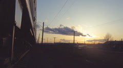 the movement of passenger trains in the evening in the countryside - stock footage