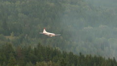 Forest fire, 2nd unit, Air tanker retardant drop tight follow shot - stock footage