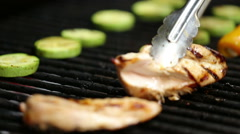 Pieces of chicken and vegetables preparing on grill grate Stock Footage