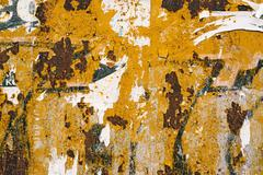 Corroded metal plate texture and poster paper scraps Stock Photos
