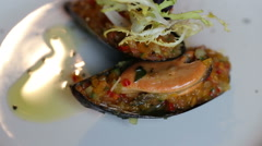 Mussels stuffed with vegetables. Colorful beautiful dish decorated with verdure Stock Footage