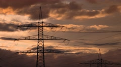 Electrical cables with a power pole and a red sky Stock Footage