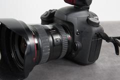 Profil view digital photo camera isolated on grey - stock photo