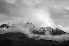 Russian mountains in black and white, mountains immersed in the clouds Stock Photos