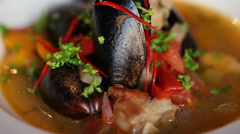 Soup with mussels beautiful dish. Plate rotates. Stock Footage