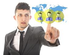 Young businessman with virtual worldwide friends isolated on white background - stock photo