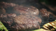Burger and cevapcici on grill Stock Footage