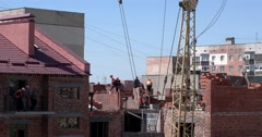 Workers Bricklaying House With Tower Crane Equipment Stock Footage