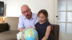Home school grandfather granddaughter Stock Footage