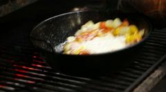 roasting vegetables in Spanish pan, peppers, tomatoes. Preparing paella. - stock footage