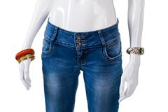Girl's blue skinny-fit jeans. - stock photo