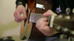 man playing an acoustic guitar - stock footage