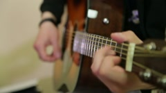 Man playing an acoustic guitar Stock Footage