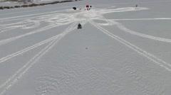 Four wheeling Across a Frozen Lake Stock Footage