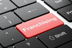 Finance concept: Franchising on computer keyboard background - stock illustration