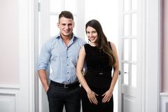 Couple of  young stylish business people in the doorway home interior loft - stock photo