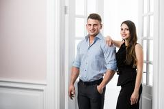 Couple of  young stylish people in the doorway home interior loft office - stock photo