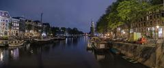 Amsterdam At Night At A Water Channel - stock photo