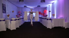 Beautiful dancing girl in white dress with feathers in White Hall. Show-ballet Stock Footage