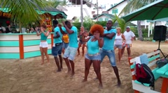 LAS TERRENAS, SAMANA, DOMENICAN REPUBLIC FEBRUARY 10 People dancing at a beac - stock footage