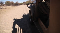 Offroad driving in sandy riverbed Stock Footage