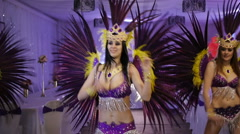 Three beautiful slim girl dancing samba in white decorated hall. Costumes in - stock footage