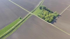Flying above agricultural fields - stock footage