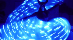 beautiful actress girl with horns on his head and unusual dancing with LED wings - stock footage