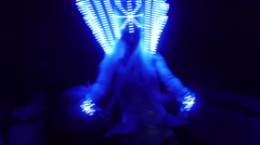 Three girls dancing in the Queen's costume with glowing at night blue Stock Footage