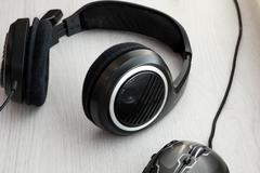 High Angle View of Modern  Audio Headphones with Cord and Mouse on Grey Desk  Stock Photos