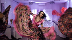 Three beautiful girls dance gypsy dance in costume in the white room. rotate Stock Footage