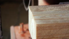 Close view. Most saw aligns edges of the boards, cutting them. Stock Footage