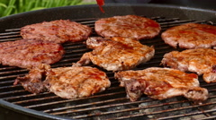 Putting sauce on burgers and steaks Stock Footage