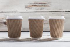 Ripple cups with lids. - stock photo