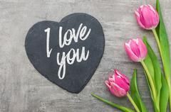 I love you written on a heart shaped sign - stock photo