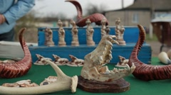 Gift Items Sets From a Variety of Bones, Teeth, Horns and Carvings on Table Stock Footage