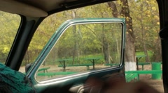 A Man Sits in Car in Front Seat First-Person View From Back Seat Stock Footage