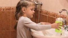 Five-year old girl rinsing mouth after brushing teeth Stock Footage
