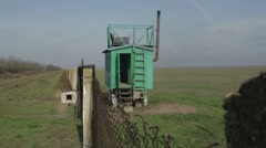 A Guard Wagon Near the Chain-Link Fence in a Field Stock Footage
