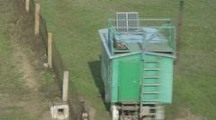 Green a Guard Wagon at Chain-Link Fence Top View From Height Through the Blurry Stock Footage