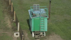 Green Guard Wagon at Mesh Fence With a Height of a Top View Stock Footage