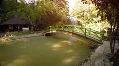 Cement Foot Bridge at Base of Prenn Waterfall in Vietnam Stock Footage