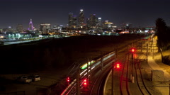 Time lapse of MTA Metro train rail tracks and the Los Angeles skyline at night Stock Footage