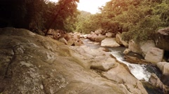 Water Flowing along Rocky River Bed in Vietnam, with Sound Stock Footage