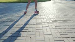 Attractive young woman rollerblading in part in the morning, slowmo - stock footage