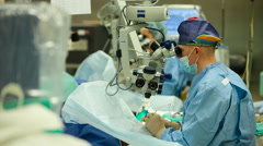 Ophthalmology. Male Doctor Conduct Eye Surgery With Using a Microscope and a Stock Footage