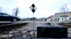 Blurred Overexposed Pan Shot with Cars and People at Railroad Crossing Stock Footage