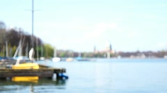 Sailboat Moored on Jetty at Lake in Abstract Unfocused Scene - stock footage