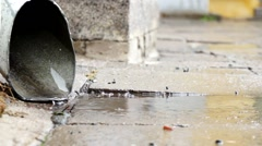 Rain Water Running Out Pipe Stock Footage