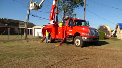 OG&E Linemen Crew Fixing Power Lines Wide Tilt Up from Truck to Worker Stock Footage